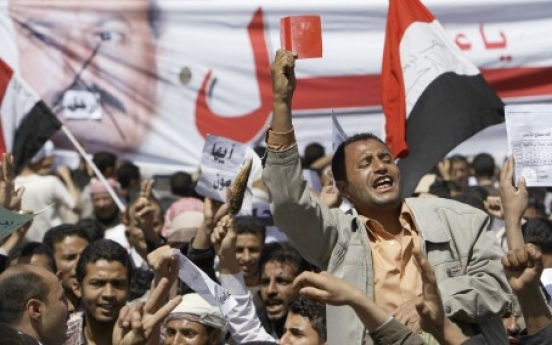 Yemeni president digs in as protests spread