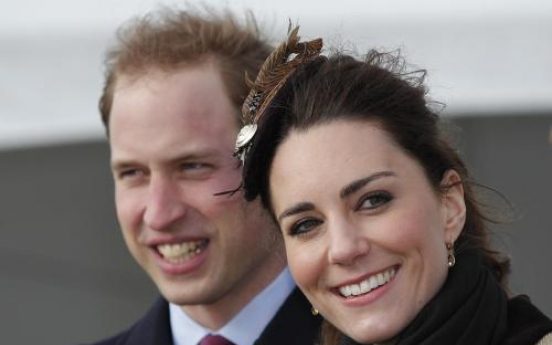 Bubbly Kate and William launch lifeboat before wedding
