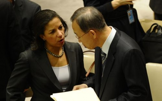 UN council slaps sanctions on Libya's Gadhafi
