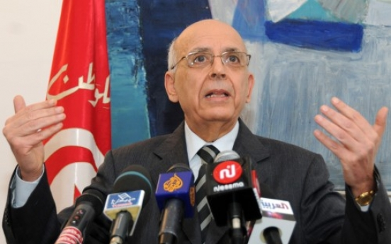 Tunisia gets new premier after new violence