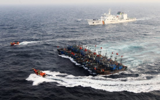 Coast guard fires on Chinese fishing boat