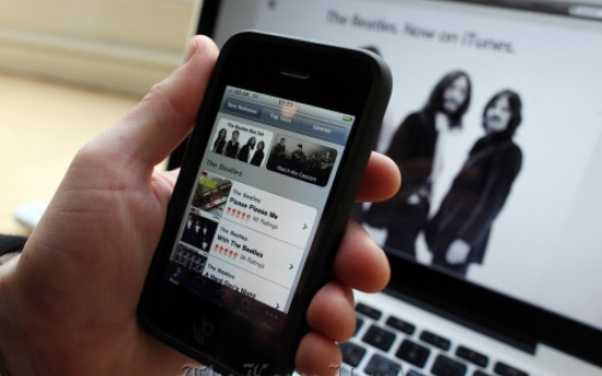 Apple to talk on unlimited downloads of bought music