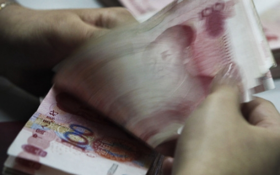 China may deflect pressure with smaller surplus