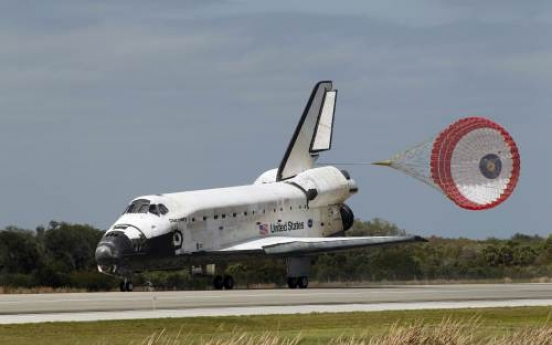 Discovery lands after final voyage