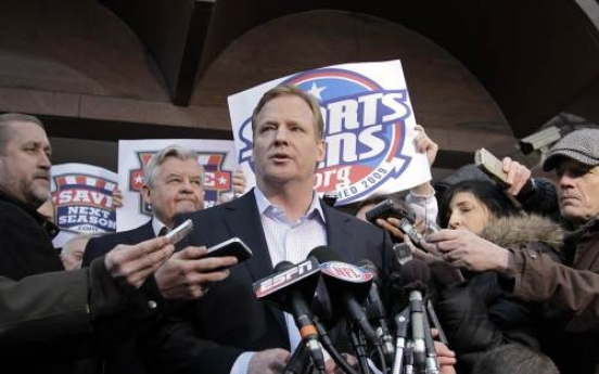 Lockout, lawsuit put NFL on hold
