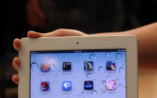 Fans line up for new iPad