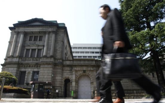 Japan feeds more money to banks