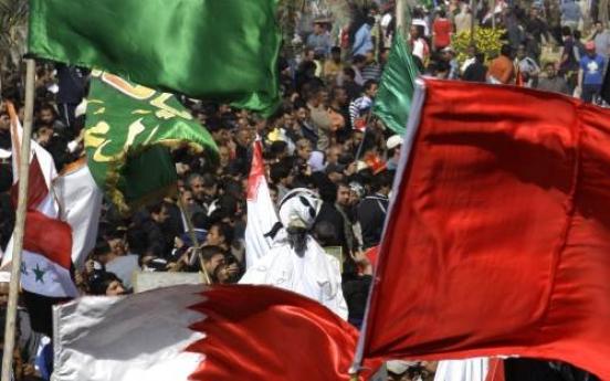 Bahrain curfew as uprising surges