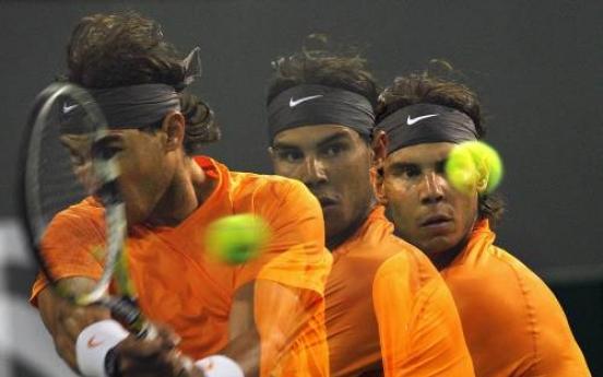 Nadal struggles but moves on