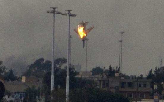 Allies launch Libya force as Gadhafi hits rebels