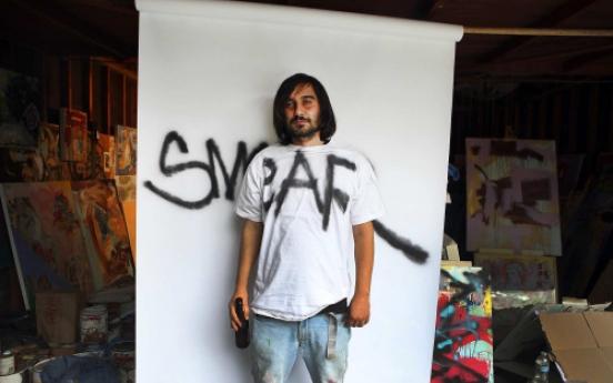 Graffiti artist puts tagging behind him