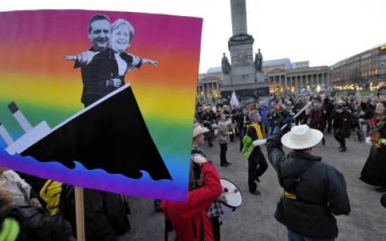 Merkel's conservatives lose German state ballot