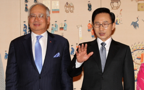 President Lee pledges to share river development experience with Malaysia