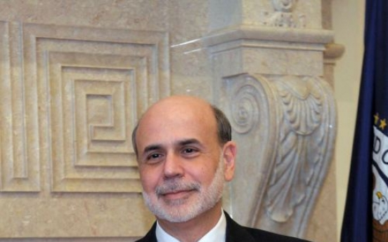 Bernanke: Fed to improve financial oversight