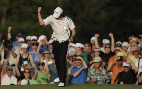 McIlroy clings to Masters lead
