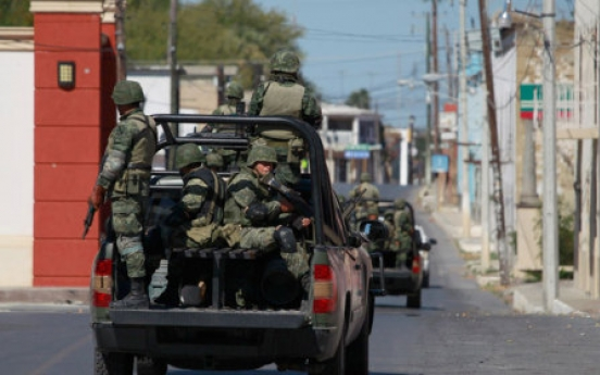 Number of bodies found Mexico state rises to 122
