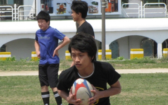 Rugby clinic puts Malaysian students in touch