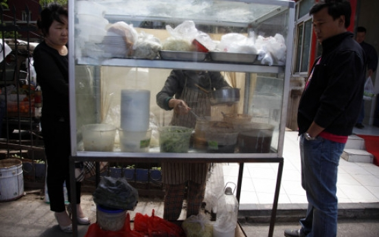 China gives press freedom ― on food safety