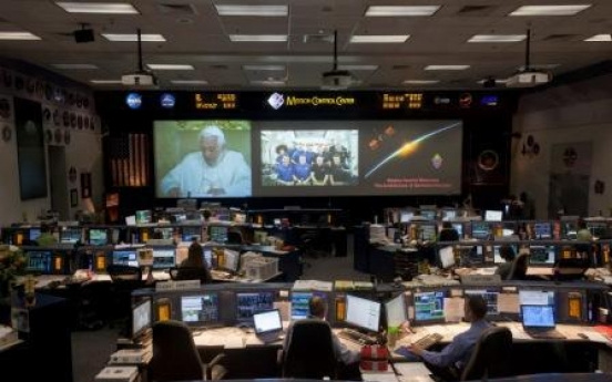 Pope blesses astronauts in 1st papal call to space