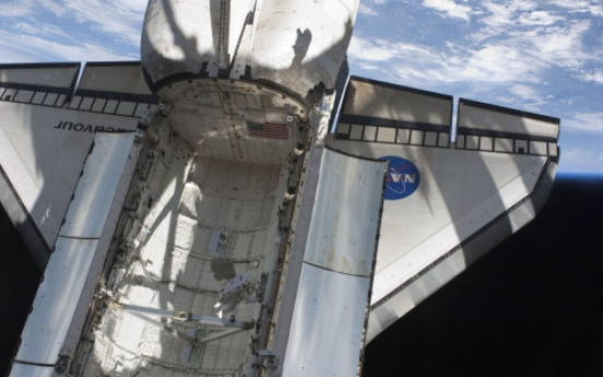 Unprecedented photo op for shuttle-space station