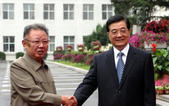 Kim, Hu discuss widening economic cooperation
