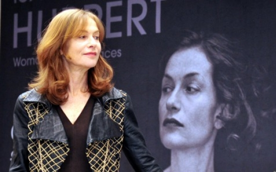 Huppert shows unknown sides in Seoul