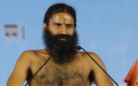 Police break up yoga guru's hunger strike