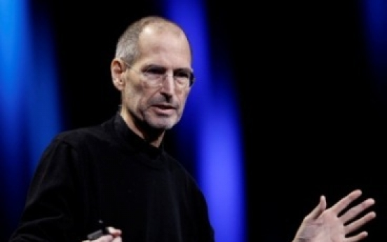 Still-frail Jobs appears to hail Apple's latest