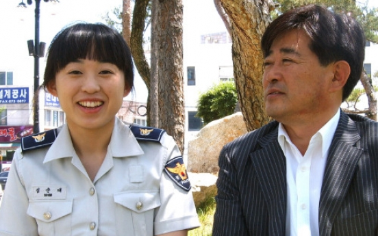 Daughter follows father's footsteps, joins police force