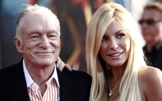 Playboy's Hefner says Playmate called off wedding