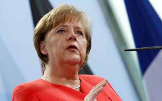 Merkel warns against Greek debt restructuring