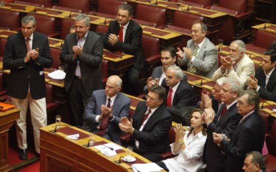 Greece passes cuts as riots seize capital