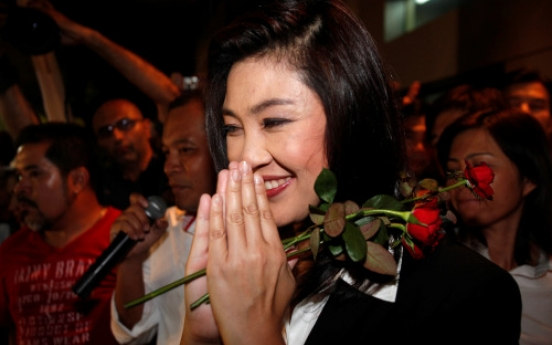 Thaksin party wins landslide Thai election victory