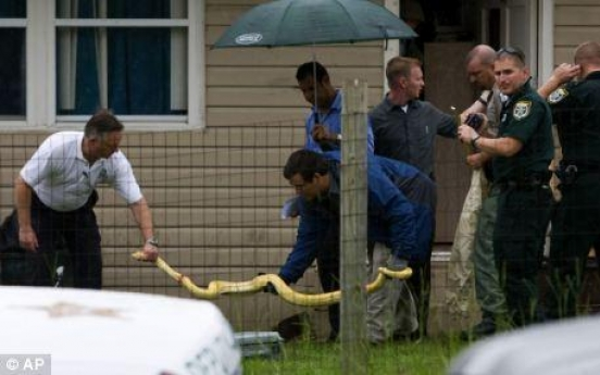 Parents on a trial as a pet python kills two-year-old daughter