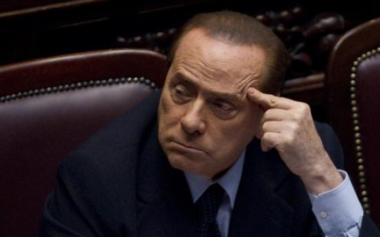 Berlusconi faces hearings on bribery, sex crime