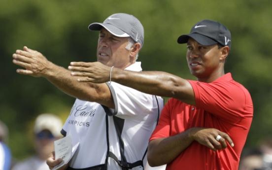 Tiger dumps longtime caddie