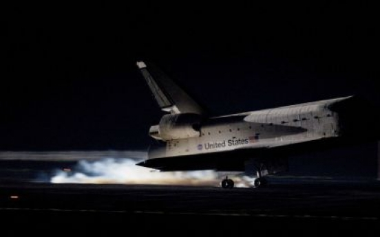 Last space shuttle comes home, ends 30-year era