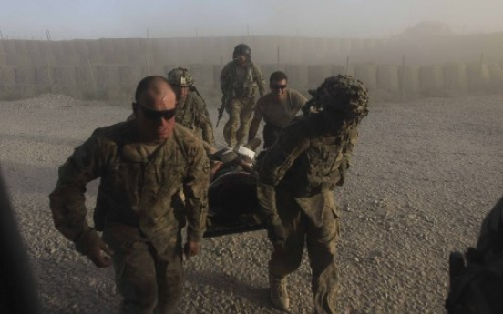Afghan transition tempered by violence