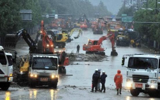 Rain triggers more landslides, flash floods
