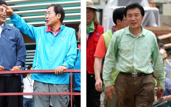 Leaders delay vacation for flood relief