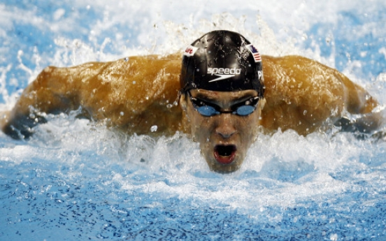 Phelps takes 3rd gold at swimming worlds