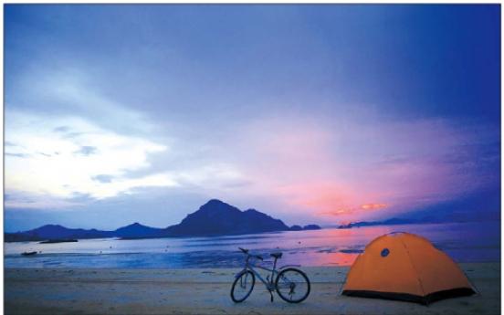 Ride bikes in red sunsets on Seonyu Island