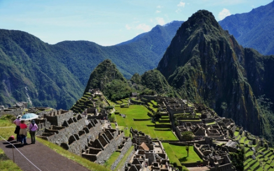 A century after rediscovery, Machu Picchu still dazzles, which may be its downfall