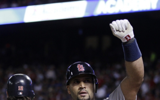Pujols buries Rangers with three homers