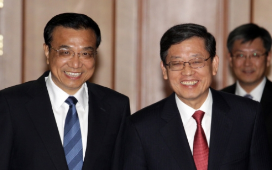 Korea, China agree to double currency swap facility