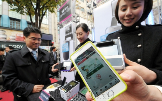 In Myeong-dong, mobile phones replace credit cards