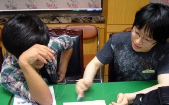 Volunteers help N. Korean defectors cross over to new world in the South