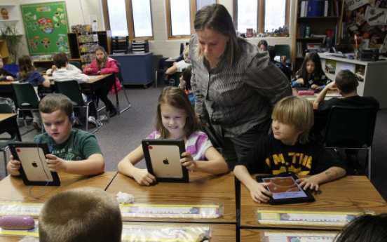 Students learn with donated iPads