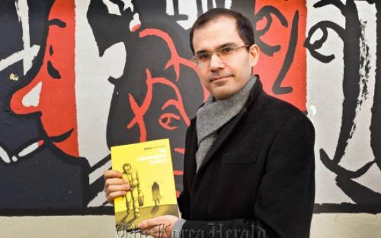 Exiled Iranian cartoonist vows to fight regime with drawings