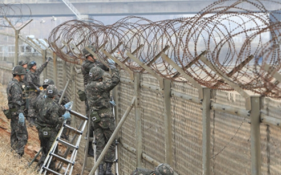 Military begins removing river fences